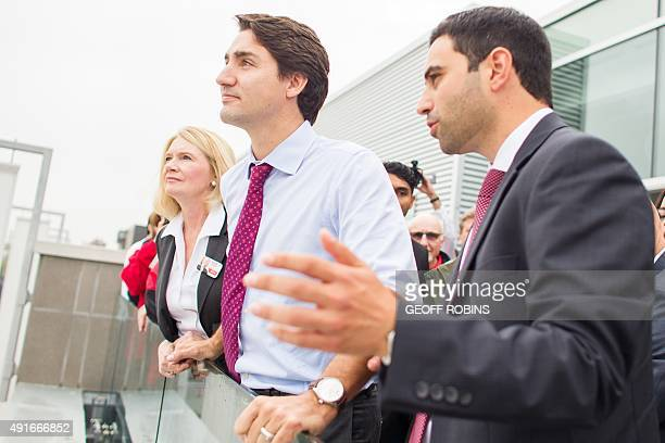 Liberal leader Justin Trudeau looks out over downtown London Ontario with local candidates Kate Young and Peter Fragiskatos during a campaign stop at...
