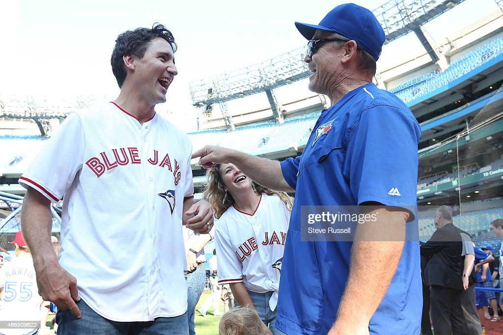 TORONTO, ON- SEPTEMBER 4 - Liberal Leader Justin Trudeau shares a laugh with Toronto Blue Jays manager John Gibbons as the Toronto Blue Jays play the Baltimore Orioles at the Rogers Centre in Toronto. September 4, 2015.