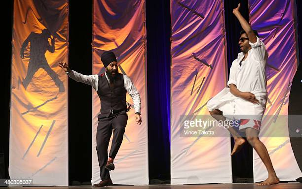 TORONTO ON MARCH 22 Liberal MPP Jagmeet Singh dances on stage with Banugan Kanagaratnamone of the emcee's for Thaalam The Ultimate Gaana Dance...