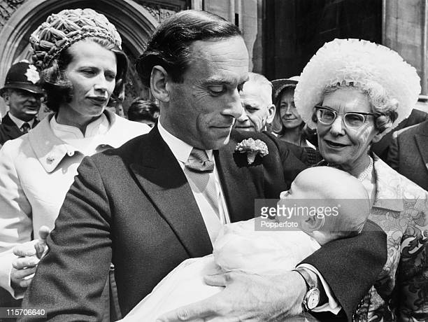 Liberal party leader Jeremy Thorpe holding his son Rupert after the baby's christening in the crypt of the Palace of Westminster London on 8th July...