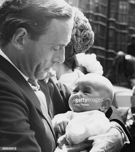 Liberal Party leader Jeremy Thorpe holding his son Rupert prior to the baby's christening outside the House of Commons London July 8th 1969