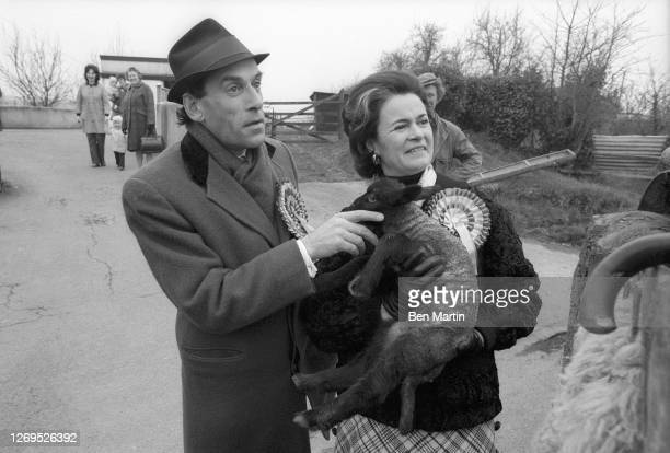 Liberal Party Leader Jeremy Thorpe with wife Marion Stein holding a baby sheep in Devonshire, England, February 1974.