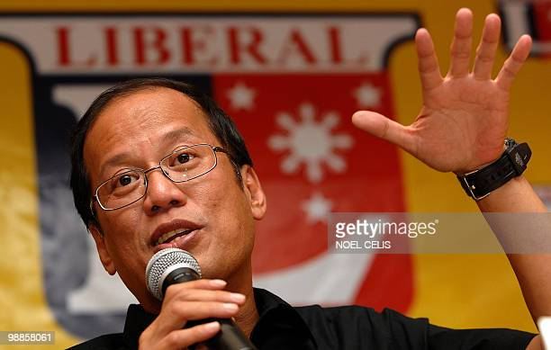 Liberal Party standard bearer Benigno 'Noynoy' Aquino son of democracy icon Corazon Aquino gestures during a press conference in Quezon City east of...