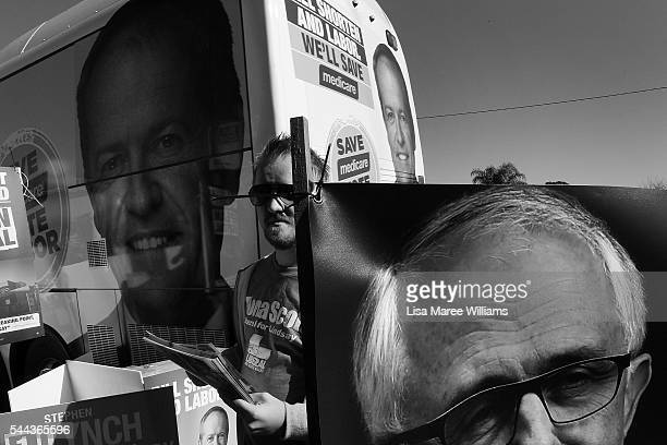 A Liberal Party supporter hands out campaign leaflets at a polling booth as the Bill Shorten bus pulls up at Colyton on July 2 2016 in Sydney...