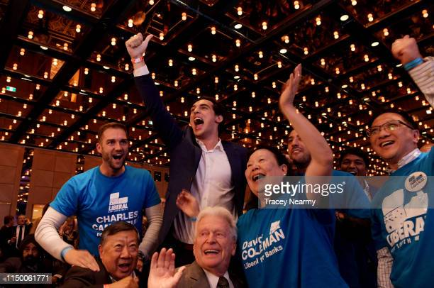 Liberal party supporters celebrate seats won as they wait for the Prime Minister Scott Morrison to arrive at the Coalition's official Election Night...