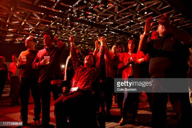 Liberal supporters react as they watch results roll in at Canadian Prime Minister Justin Trudeau's election night headquarters on October 21 2019 in...