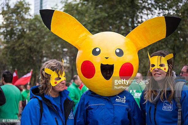 Liberal union members wear quotPikachuquot masks during a demonstration against the centerright government's austerity policy after various labor...
