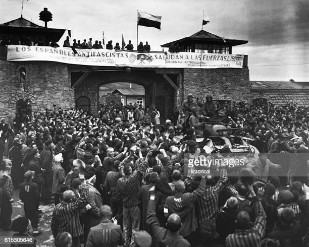 Liberated prisoners in the Mauthausen concentration camp near Linz Austria give rousing welcome to Cavalrymen of the 11th Armored Division The...