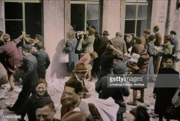 Liberated Slave Laborers Help Themselves to Food and Supplies in Store, Hanover, Germany, Central Europe Campaign, Western Allied Invasion of...