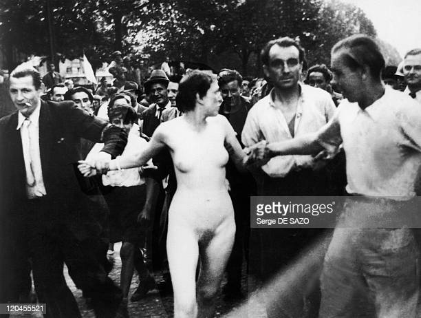 Liberation In Paris France In 1944 A woman collaborator undressed by the crowd during the liberation