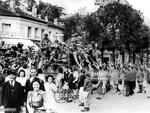 Liberation of Paris August 1944 A lorryload of American soldiers are enthusiastically welcomed by the city's populace