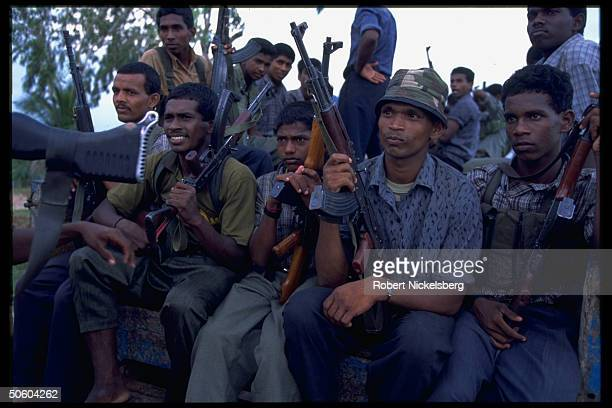 Liberation Tigers of Tamil Eelam guerrillas riding on back of truck armed in separatist struggle
