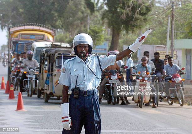 Liberation Tigers of Tamil Eelam police officer directs early morning traffic on the main street of the rebelheld town of Kilinochchi some 250...