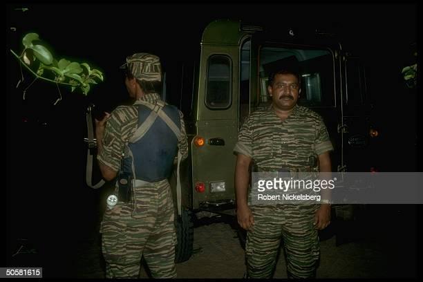 Liberation Tigers of Tamil Eelam rebel ldr Velupillai Prabakaran w LTTE fighter in northern jungles of Sri Lanka
