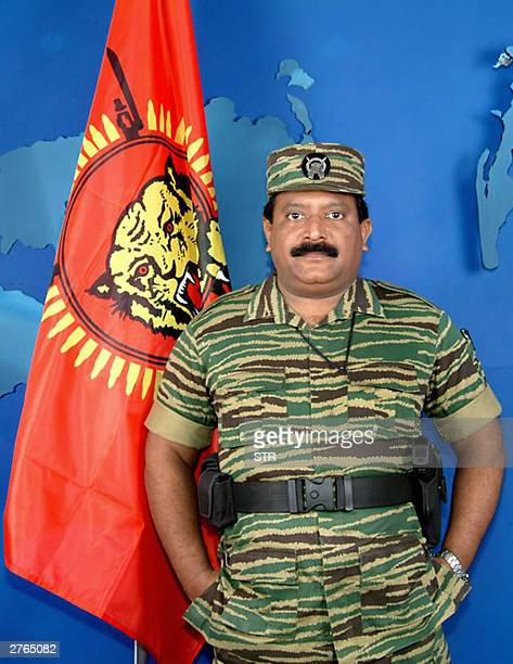 Liberation Tigers of Tamil Eelam supremo Velupillai Prabhakaran stands next to the LTTE flag during his annual Heroes' Week address to his people...