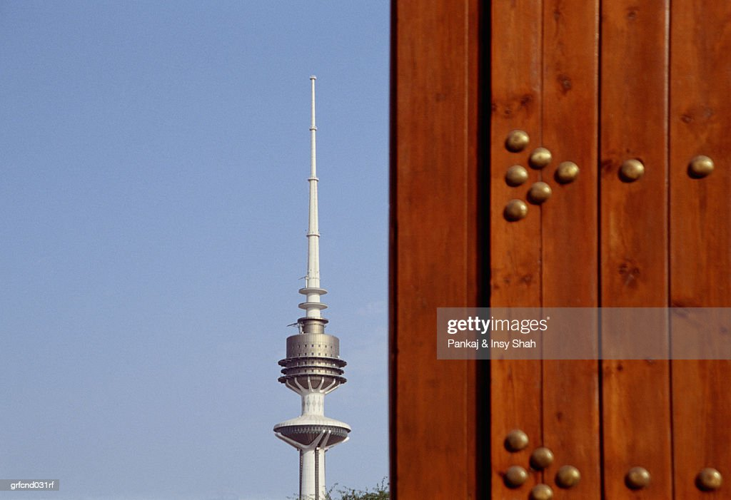 Liberation Tower In The City Of Kuwait Along Side A Door