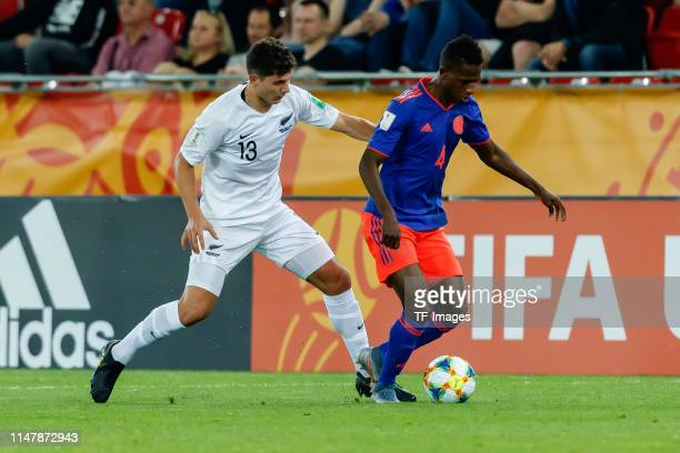 Liberato Cacace of New Zealand and Anderson Arroyo of Colombia battle for the ball during the 2019 FIFA U20 World Cup Round of 16 match between...