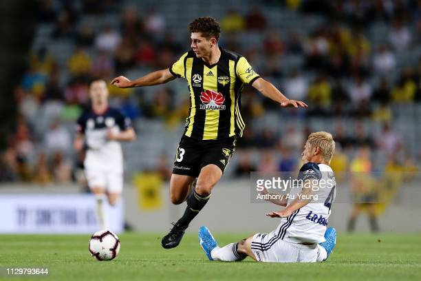 Liberato Cacace of the Phoenix dribbles past Keisuke Honda of the Victory during the A-League match between the Wellington Phoenix and the Melbourne...