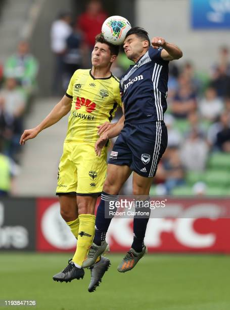 Liberato Cacace of the Wellington Phoenix and Andrew Nabbout of the Victory compete for the ball during the round 10 A-League match between the...