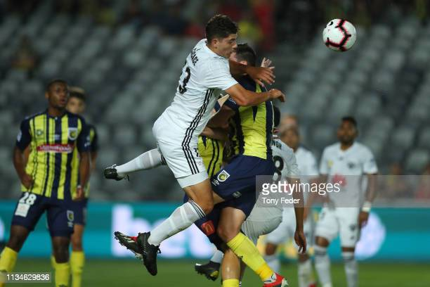 Liberato Cacace of Wellington Phoenix heads the ball during the round 21 ALeague match between the Central Coast Mariners and the Wellington Phoenix...