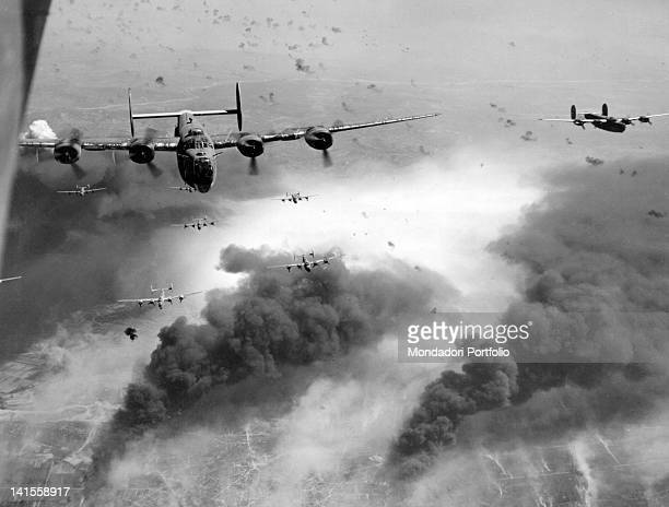 Liberator B24 bombers of the Allied 15th Air Force in action to shoot an oil refinery among the shots of the air defence Ploiesti August 1944