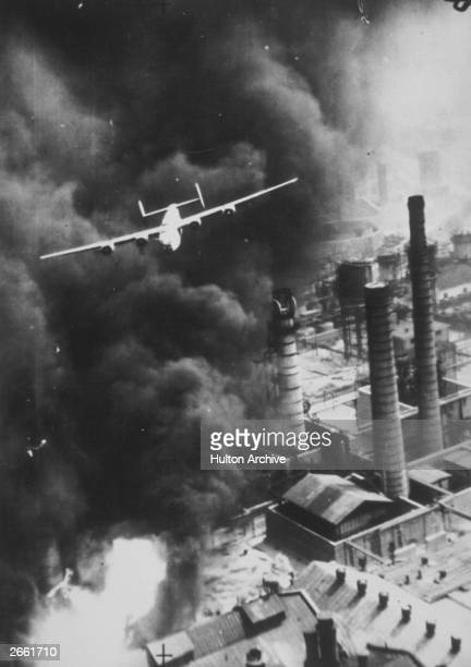 Liberator barely missing the smokestacks in Ploesti RomaniaThe heavy pall of smoke is from fires probably started by incendiary bombs and gunfire...