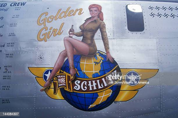 Liberator bomber is decorated with the Schlitz Golden Girl logo and swastika marks for the number of German planes downed during World War II The...