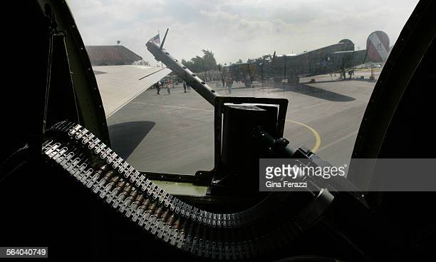 Liberator is framed through a gunner's window inside a WWII B–17 Flying Fortress which are on display at Mercury Air Center in Ontario Called The...