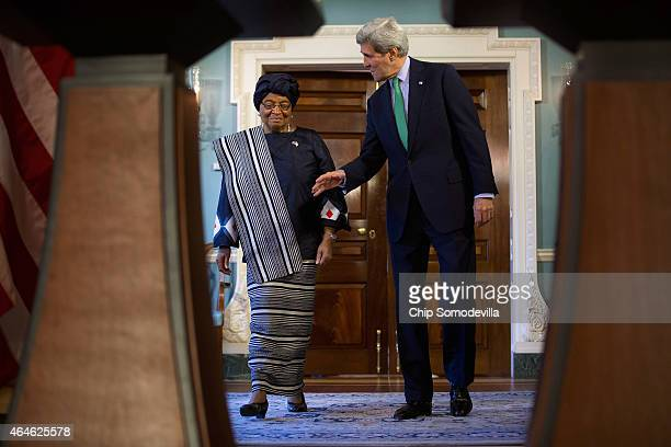 Liberia President Ellen Johnson Sirleaf and US Secretary of State John Kerry arrive for a media availability in the Treaty Room at the Department of...