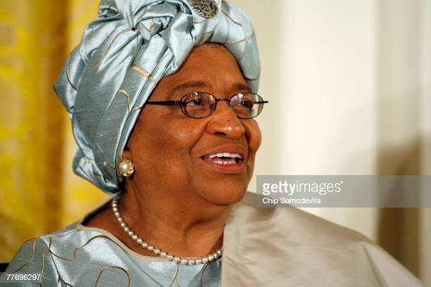 Liberia president Ellen Johnson Sirleaf smiles before being presented the 2007 Presidential Medal of Freedom in the East Room of the White House...