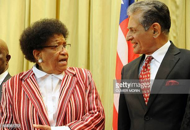 Liberia President Ellen Johnson Sirleaf speaks with UN Special Representative Farid Zarif during a ceremony to mark the security handover from UN...