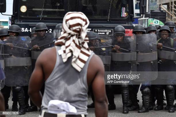 TOPSHOT Liberian antiriot policemen take part in an exercise in Monrovia on October 9 on the eve of the country's presidential elections Liberians go...