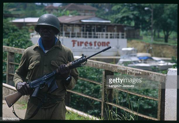 Liberian Army troops control the Firestone rubber plantation in Monrovia during the Liberian Civil War The violent conflict is taking place between...