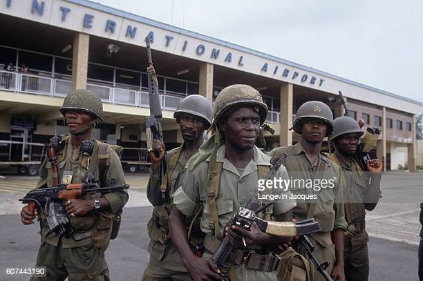 Liberian Army troops control the international airport in Monrovia during the Liberian Civil War The violent conflict is taking place between the...