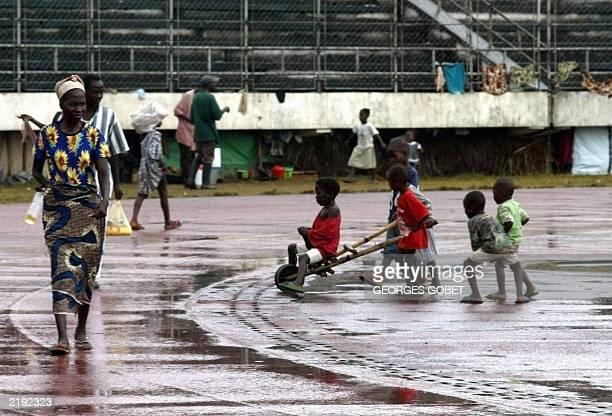 Liberian displaced children play at the Samuel Kanyon Doe stadium in Monrovia 14 July 2003 The International Red Cross began distributing today food...