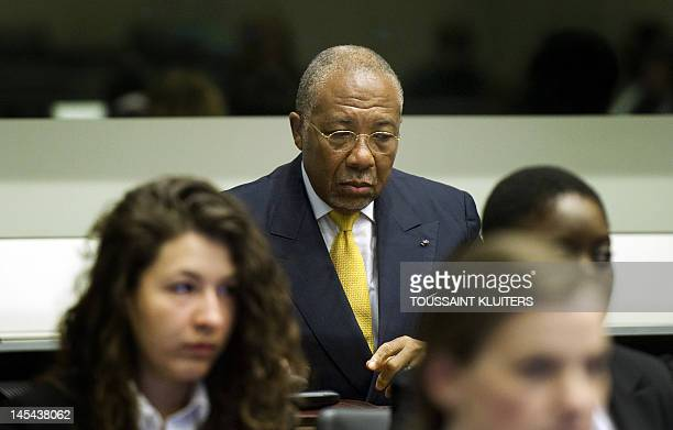Liberian expresident Charles Taylor accused of arming Sierra Leone's rebels who paid him in 'blood diamonds' listens to the judge at the opening of...