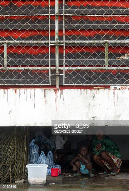 A Liberian family displaced by war takes shelter under the Samuel Kanyon Doe stadium stands 14 July 2003 in Monrovia The International Red Cross...