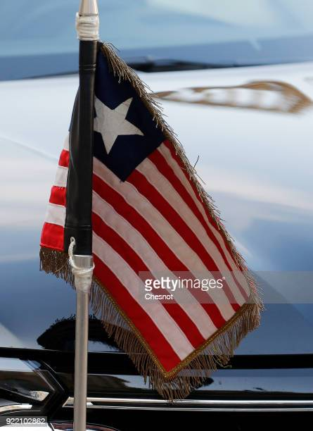 Liberian flag is seen on the hood of the car of the Liberian President George Weah prior to his meeting with French President Emmanuel Macron at the...