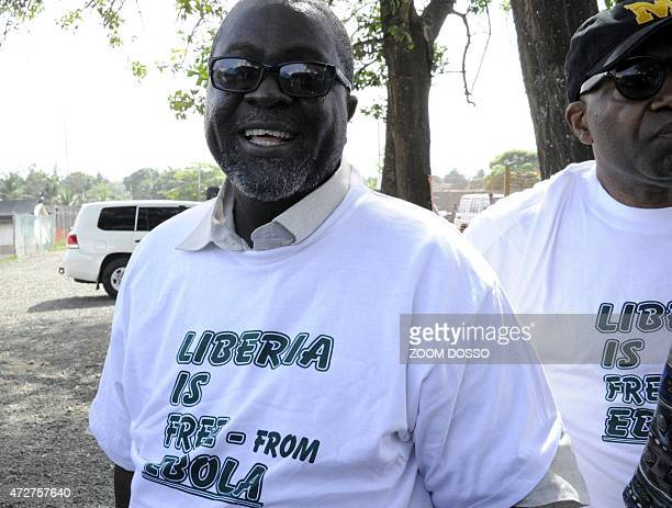Liberian information minister Lewis Brown wears a t shirt reading 'Liberia is free from Ebola' during an announcement ceremony hosted by the World...