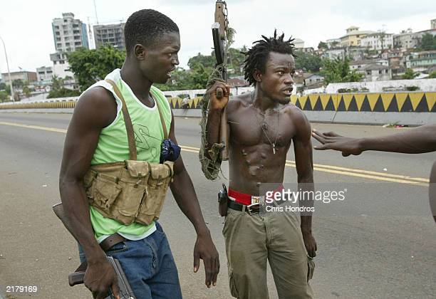 Liberian militia soldiers organize during an assault on a key strategic bridge July 20 2003 in Monrovia Liberia Government forces succeeded in...