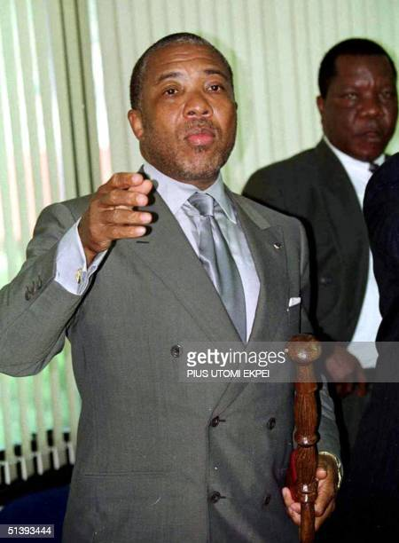 Liberian President Charles Taylor draws the attention of an official 11 April 2001 at the end of the oneday extraordinary summit of Heads of state...