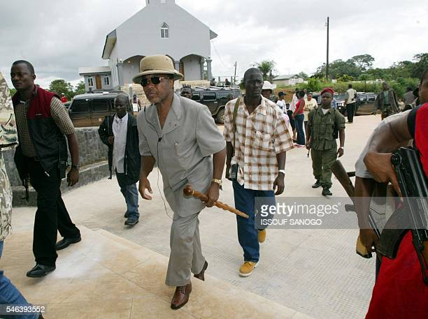 Liberian President Charles Taylor visits a church in Attington Liberia 14 June 2003 Liberian rebels 14 June said they would not sign a truce to end a...