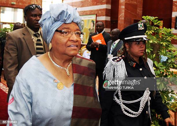 Liberian President Ellen Johnson Sirleaf arrives to attend the second day of the 13th African Union summit of heads of state and government in Sirte...