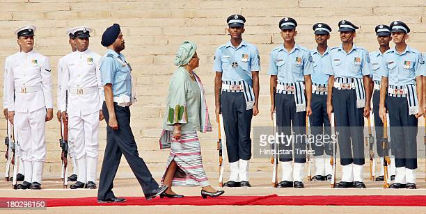 Liberian President Ellen Johnson Sirleaf inspecting the guard of Honour during her ceremonial reception at Rashtrapati Bhawan on September 11 2013 in...