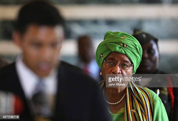 Liberian President Ellen Johnson Sirleaf listens to American USAID Administrator Rajiv Shah speak at a joint press conference on October 14 2014 in...
