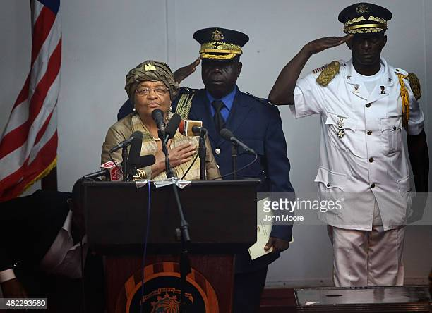 Liberian President Ellen Johnson Sirleaf stands for the national anthem before delivering her State of the Nation address to a joint session of the...