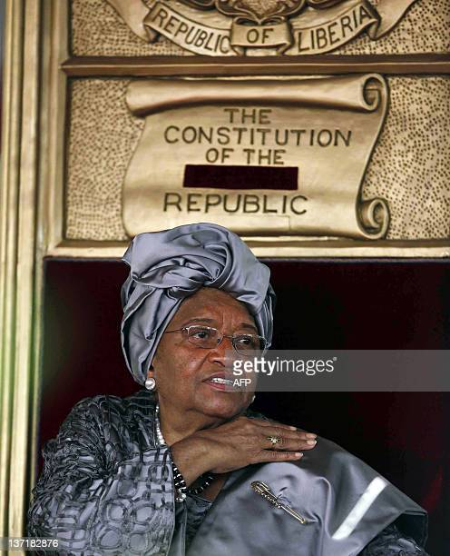 Liberian President Ellen JohnsonSirleaf sits after speaking during her second presidential inauguration in Monrovia on January 16 2012 Africa's first...