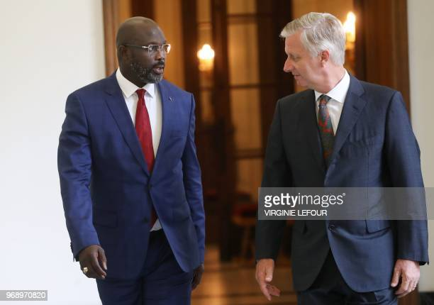Liberian President George Weah and King Philippe of Belgium arrive for a diplomatic meeting at the Royal Palace in Brussels on June 7 2018 / Belgium...