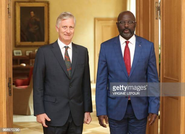 Liberian President George Weah and King Philippe of Belgium pose prior to a diplomatic meeting at the Royal Palace in Brussels on June 7 2018 /...