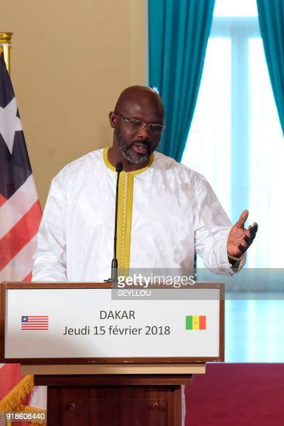 Liberian president George Weah hold a joint press conference with the Senegalese president during their meeting at the presidential palace in Dakar...